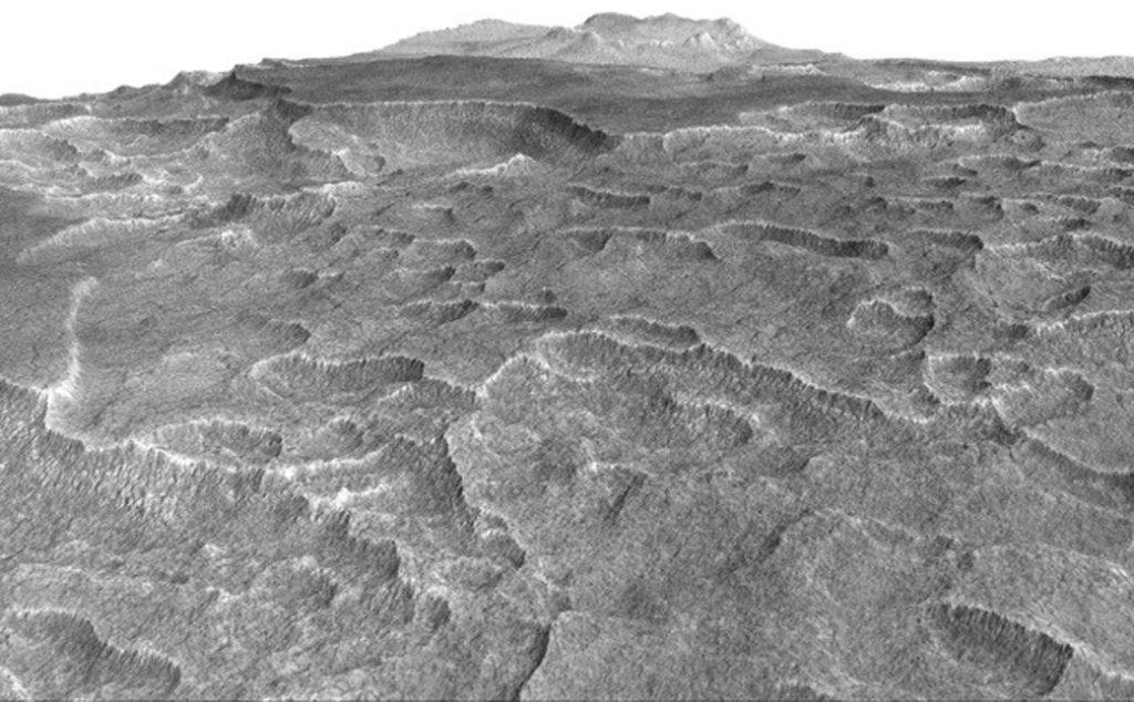 Kanada'nın yüzey altında buz saklayan bölgelerine benzerlik gösteren yüzey üzerindeki taramalar, Mars'ta aynı sonucu ortaya çıkardı. [NASA/JPL-Caltech/Univ. of Arizona]